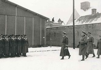 LITTLE, BROWN Heinrich Himmler visits the Ravensbrück camp in January 1940.